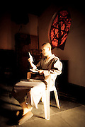 monk reading a letter from home in China