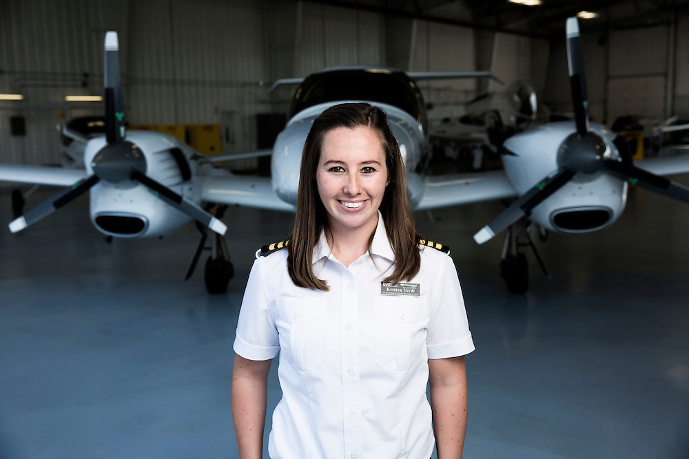 Kristen Verdi a UVU student and flight instructor in the Aviation program poses for a portrait in the UVU hanger at the Provo airport. Also she helps a student pilot Dustin Romrell of Provo (208-716-2773) go over a pre-flight check list as they prepare to taxi out to the runway in Provo, Utah Monday July, 10, 2013.