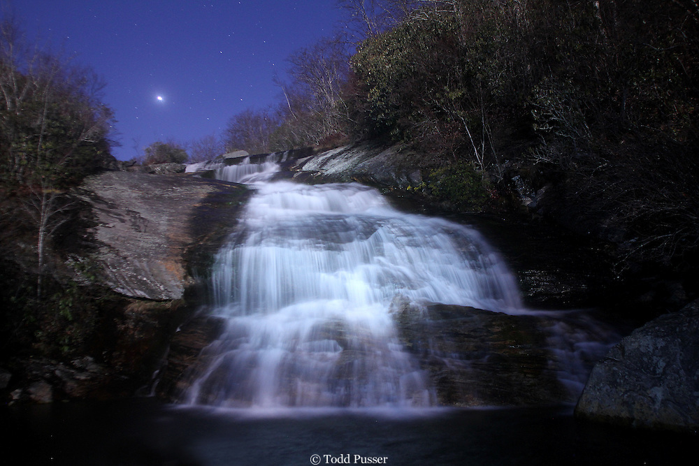 The planet Venus shining over a waterfall on a clear mountain night.  Graveyard Fields, Blue Ridge Parkway, North Carolina