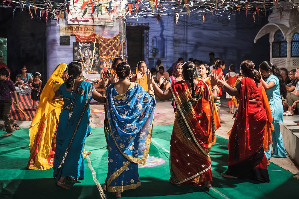 Indian women dancing at the Durga festival in Bundi