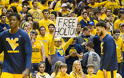 Feb 6, 2016; Morgantown, WV, USA; A West Virginia Mountaineers fan holds up a sign prior to their game against the Baylor Bears at the WVU Coliseum. Mandatory Credit: Ben Queen-USA TODAY Sports