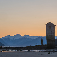 It had been clear in Juneau for quite a few days in a row so I took advantage of this and headed to Sandy Beach to photograph the Treadwell Mine Pump House. In the winter sunrise will happen down the Gastineau Channel which allows the sunrise color to fall behind the pump house which I captured just prior to the start of winter. On this morning, low tide had just occurred at 1.2′ and it was starting to head towards the 20.1′ just after lunch.<br /> <br /> The Pump House is one of the few remaining structures of Treadwell and is a well known site for those familiar with the Juneau area.