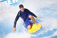 Royal Caribbean International's  Independence of the Seas, the world's largest cruise ship.....A surfer on the Flowrider *** Local Caption *** A surfer on the Flowrider