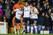 Danny Rose of Tottenham Hotspur (right) celebrates scoring his team's fourth goal against Burnley to make it 4-2 with Etienne Capoue of Tottenham Hotspur (centre) and Benjamin Stambouli of Tottenham Hotspur (right) during the FA Cup match at White Hart Lane, London<br /> Picture by David Horn/Focus Images Ltd +44 7545 970036<br /> 14/01/2015