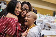Chinester Grayson, college registrar, receives hugs from students Jave Rhodes (left) and Shanquise Hamilton following the Class of 2018 Graduation & Awards Banquet in the Julius and Mary Jenkins Center on Thursday, April 26, 2018, at Concordia College Alabama in Selma, Ala. LCMS Communications/Erik M. Lunsford