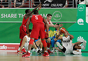 14th April 2018, Gold Coast Convention and Exhibition Centre, Gold Coast, Australia; Commonwealth Games day 10, Basketball, Mens semi final, New Zealand versus Canada; Mika Vukona of New Zealand passes the ball of the ground as Jean charles-Pierre looks on