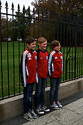 """Aristide Dubreu, from left, Nathan Dumortier and Pierre-Charles Bonnet, all 11 and visiting from Lille, France, stand in front of the White House to have their photo taken on Nov. 7, 2012 in Washington, D.C. """"For Europe it's very good,"""" said Christelle Dumortier of President Barack Obama's win of the 2012 election. """"We were waiting for his victory."""" The group spent Wednesday in Washington, D.C. during their trip to the United States."""