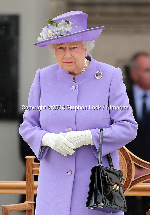 Image licensed to i-Images Picture Agency. 28/06/2014. London, United Kingdom. The Queen arriving in the rain at the Solemn Drumhead Service at the Royal Hospital Chelsea, London. The service was to commemorate those who volunteered to serve in the First World War on the Centenary of the assassination of Archduke Franz Ferdinand.  Picture by Stephen Lock / i-Images