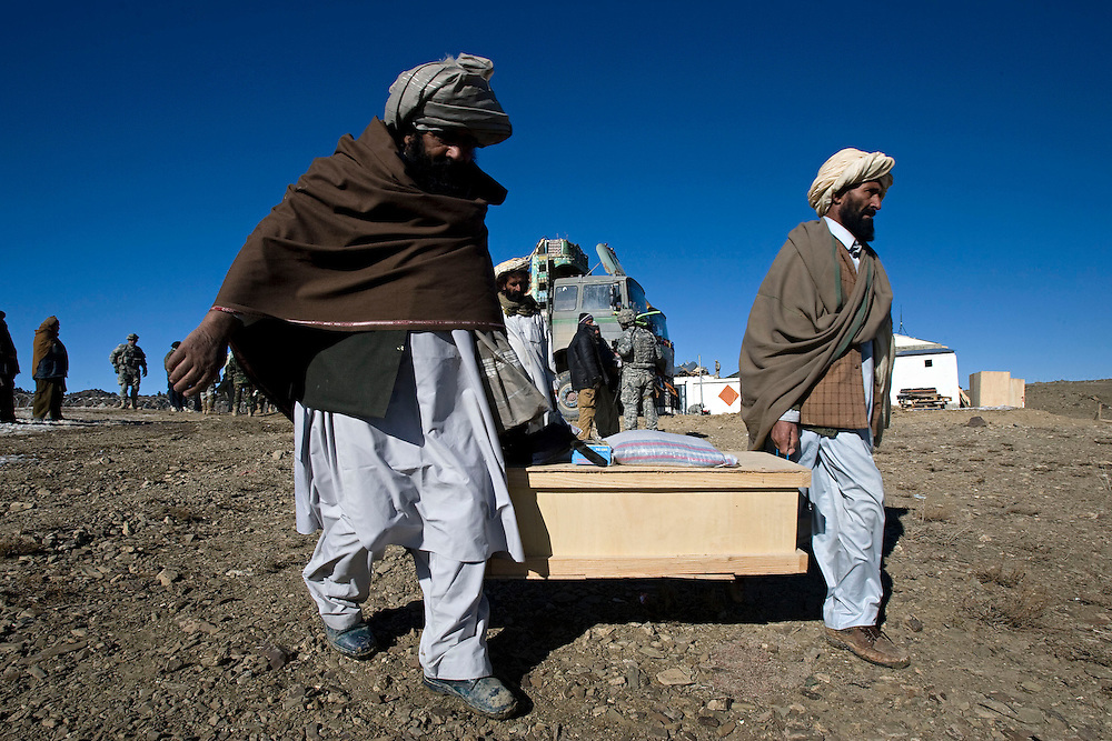 Afghan elders collect boxes of tools and bags of rice and beans at the onset of Operation Winterstand, a Humanitarian Assitance mission, part of the COIN (counter insurgency) program being actioned in Rebat, Pakitika Province, Afghanistan on the 19th of January 2008