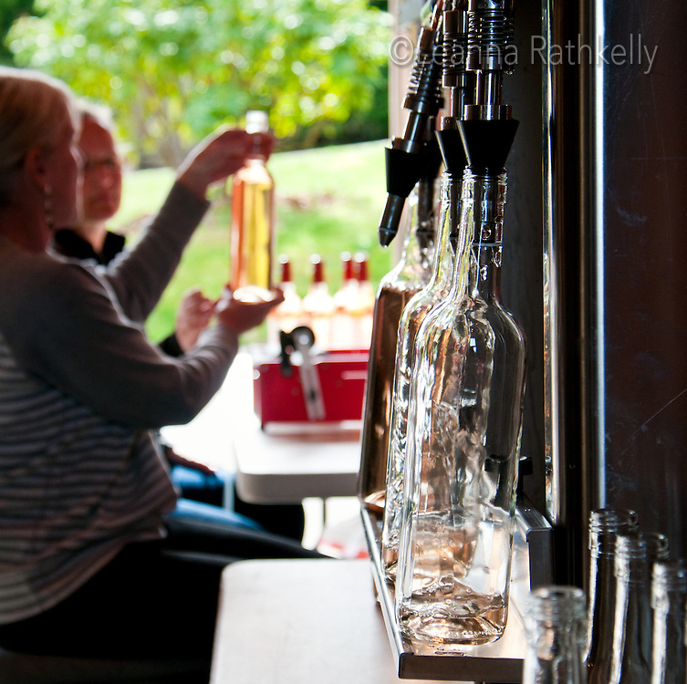 The final stage of wine creation is bottling the Pinot Gris at Symphony Vineyards, a family-owned operation in Saanich, BC on Vancouver Island.