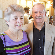 Beth Anderson, left, and Rich Anderson pose for a photo during Juice, Jazz & Java Saturday September 6, 2014 at Cape Fear National Golf Course in Leland, N.C. (Jason A. Frizzelle)