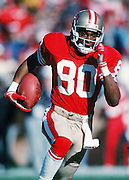 San Francisco 49ers wide receiver Jerry Rice (80) runs downfield after catching a pass during the NFC Divisional Playoff NFL football game against the Minnesota Vikings on January 1, 1989 in San Francisco, CA. The 49ers won the game 34-9. ©Paul Anthony Spinelli