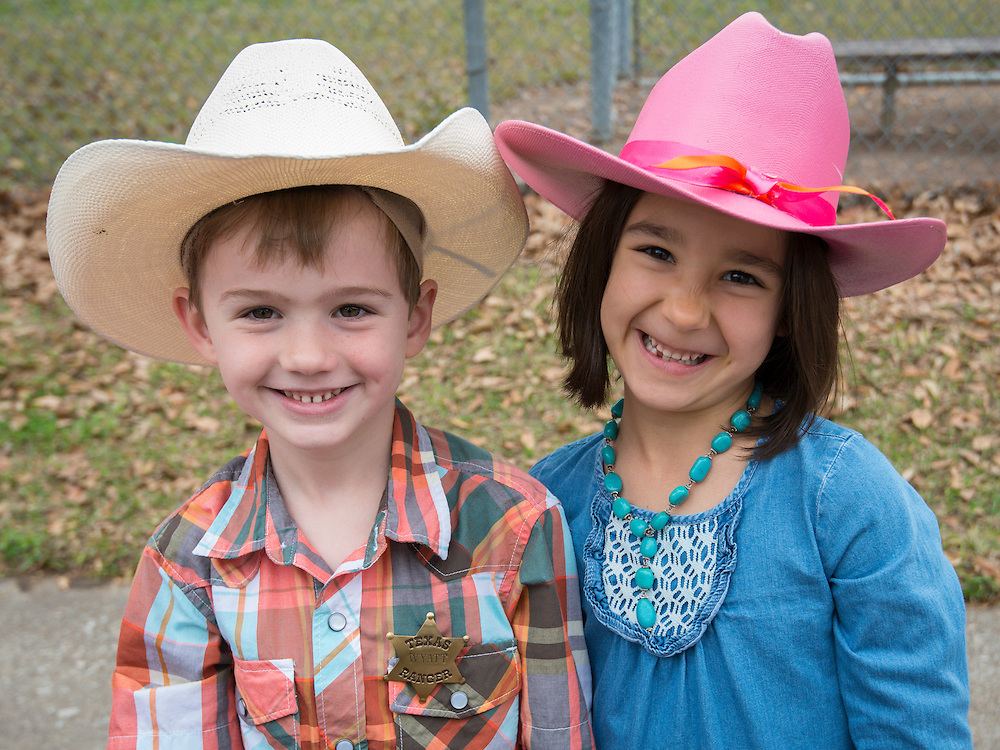 Students and staff from Lovett Elementary School meet the Vaqueros Trail Riders as part of Go Texan Day, February 28, 2014.