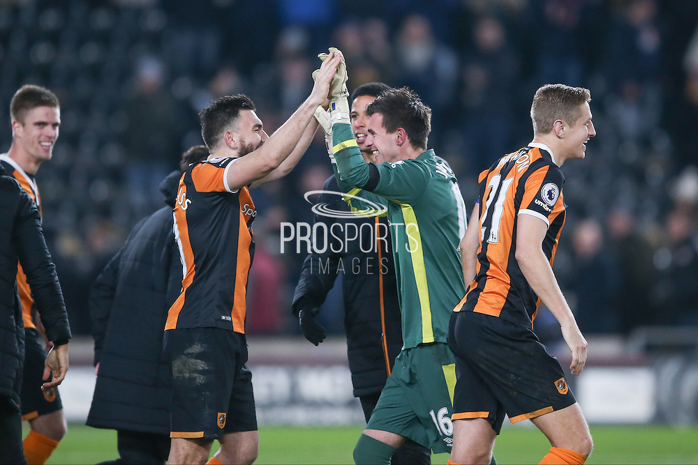Hull City goalkeeper Eldin Jakupovic (16) is congratulated after Hull City penalty success during the EFL Quarter Final Cup match between Hull City and Newcastle United at the KCOM Stadium, Kingston upon Hull, England on 29 November 2016. Photo by Simon Davies.
