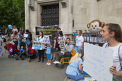 London, July 13th 2017. Protesters demonstrate outside the High Court in London as the parents of terminally ill Charlie Gard, Chris Gard and Connie Yates argue their case in a last ditch attempt to seek permission from the court to seek alternative treatment for their son's condition, Mitochondrian DNA depletion syndrome.