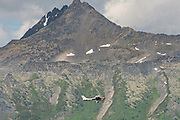 A flight seeing airplane climbs up the Chugach Mountains in Girdwood, Alaska.