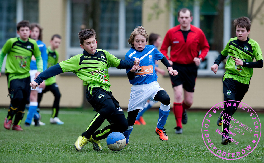 (R) RAFAL KAZUBEK (UKS LADY) FIGHTS FOR THE BALL DURING 13. ROUND SEASON 2010/2011 SOCCER LEAGUE FOR JUNIORS 1998 (UNDER'13) MATCH BETWEEN UKS LADY AND GOL WARSZAWA IN LADY NEAR WARSAW...WARSAW , POLAND , APRIL 9, 2011..( PHOTO BY ADAM NURKIEWICZ / MEDIASPORT ).
