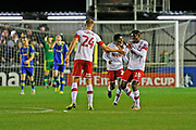 Michael Smith scores a goal to make it 3-3 and Rotherham United celebrate during the The FA Cup match between Solihull Moors and Rotherham United at the Automated Technology Group Stadium, Solihull, United Kingdom on 2 December 2019.