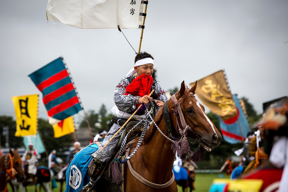 """MINAMISOMA, JAPAN - JULY 24 : A young samurai horseman is seen as he compete in the Shinki-soudatsusen (sacred flag competition) during the Soma Nomaoi festival at Hibarigahara field on Sunday, July 24, 2016 in Minamisoma, Japan. """"Soma-Nomaoi"""" is a traditional festival that recreates a samurai battle scene from more than 1,000 years ago.  (Photo: Richard Atrero de Guzman/NURPhoto)"""