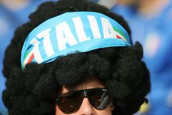 An Italy fan wearing a bandana