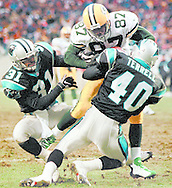 (Published caption 12/15/97) Packers' Robert Brooks scores on a 20-yard touchdown reception in the first quarter Sunday as Panthers' Rod Smith (31) and Pat Terrell defend.  The Packers beat Carolina, 31-10, in a rematch of last season's NFC Championship game. More in Sports/1D, 6-7D.