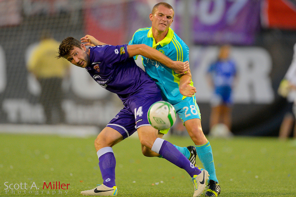 Orlando City Lions midfielder Luke Boden (14) and Seattle Sounders forward Will Bates (28) fight for a ball during a USL Pro soccer game at the Citrus Bowl on Aug. 11, 2013 in Orlando, Florida. <br /> <br /> &copy;2013 Scott A. Miller