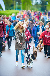 © Licensed to London News Pictures. 28/04/2018. LONDON, UK.  Rachel Riley (wearing olive coloured coat) walks retired hearing dog Ginny (cocker spaniel) during the Great British Dog Walk organised by Hearing Dogs for Deaf People. The event held in Windsor Great Park and other locations nationwide raises money for the charity to train up to 220 new dogs a year.  Photo credit: Cliff Hide/LNP