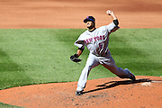 17 April 2010:New York Mets starting pitcher Johan Santana (57) stretches while releasing a pitch during Saturday's game against the St. Louis Cardinals at Busch Stadium in St. Louis, Missouri. The Game would go 20 innings, with the Mets winning 2-1.