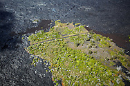 Just a small portion of a road is spared by the lava on the Big Island, HI.