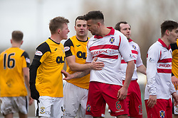 East Fife&rsquo;s Stevie Campbell and Stirling Albion's Scot Buist after was tackled East Fife&rsquo;s Kevin Smith and a small melee starts. <br /> East Fife 1 v 0 Stirling Albion, Scottish Football League Division Two game played atBayview Stadium, 20/2/2106.