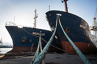 """PALERMO, ITALY - 6 JUNE 2016: (L-R) Cargo ships Munzur and Meryem, seized respectively in December 2015 with 13 tons of hashish and in June 2015 with 20 tons of hashish within the """"Operazione Libeccio"""", are docked here in the harbor of Palermo, Italy, on June 6th 2016.<br /> <br /> Between January 2014 e December 2015 more than 120 tons of hashish, carried on fishing boats or cargo ships from Morocco to Libya, were seized in the Strait of Sicily by Italy's Guardia di Finanza (Financial Police) thanks to an international police investigation named """"Operazione Libeccio"""", carried out by the GICO (Gruppo Investigativo Criminalità Organizzata, Organised Crime Investigation Group), a unit of the tax police of Palermo under the supervision of the DDA (Direzione Distrettuale Antimafia) of Palermo.<br /> <br /> """"What is happening in Libya is same historical occurrence that happened years ago in Afghanistan. Such as the Talibans who financed their terroristic activities with heroin trafficking for the purchase of weapons, the Caliphate is proposing the same terroristic strategy by purchasing and commercialising hashish in order to purchase weapons used in their war"""" Sergio Barbera, Deputy General Prosecutor of Palermo, said."""