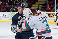 KELOWNA, CANADA - FEBRUARY 8: Josh Ulrich #22 of the Seattle Thunderbirds drops the gloves with Riley Stadel #3 of Kelowna Rockets on February 8, 2016 at Prospera Place in Kelowna, British Columbia, Canada.  (Photo by Marissa Baecker/Shoot the Breeze)  *** Local Caption *** Josh Ulrich; Riley Stadel;
