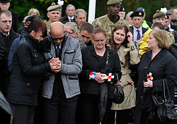 © Licensed to London News Pictures. 9th May 2013. Carterton.  REPATRIATION of Cpl William Savage and Fusilier Samuel Flint from the Royal Highland Fusiliers, the 2nd Battalion The Royal Regiment Of Scotland and Pte Robert Hetherington, of the 51st Highland, 7th Battalion - a Territorial Army member..Their Mastiff armoured vehicle was hit by a roadside device during a routine patrol in Helmand on 30 April.. Photo credit : MarkHemsworth/LNP