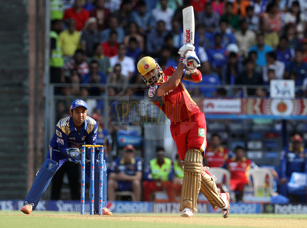Royal Challengers Bangalore captain Virat Kohli plays a shot during match 46 of the Pepsi IPL 2015 (Indian Premier League) between The Mumbai Indians and The Royal Challengers Bangalore held at the Wankhede Stadium in Mumbai, India on the 10th May 2015.<br /> <br /> Photo by:  Vipin Pawar / SPORTZPICS / IPL