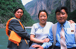 CHINA SICHUAN PROVINCE THREE LITTLE GORGES MAY99 - Two Chinese tourists and a guard pose for a photo on the way to the Three Little Gorges, a famous landmark of China's Sichuan province. Seven large cities, including Chongquing, and thousands of villages will be submerged once the water level rises after the completion of the controversial Three Gorges Dam project further downriver. The flooding of areas reaching back more than 550Km upriver will require the evacuation and resettlement of more than 10 million people.  jre/Photo by Jiri Rezac. © Jiri Rezac 1999. . Contact: +44 (0) 7050 110 417. Mobile:  +44 (0) 7801 337 683. Office:  +44 (0) 20 8968 9635. . Email:   jiri@jirirezac.com. Web:     www.jirirezac.com