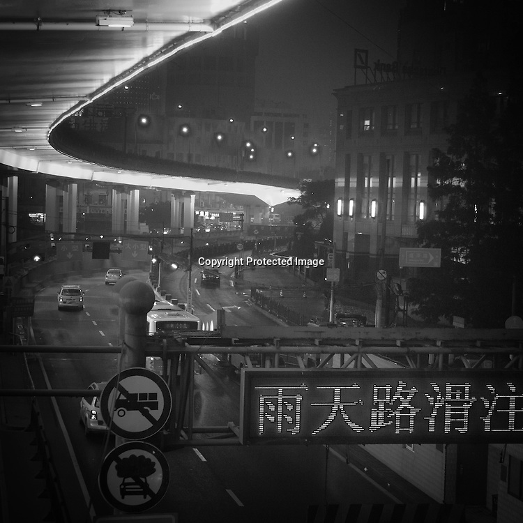 China, Shanghai. Yen'an road, urban highway illuminated at night