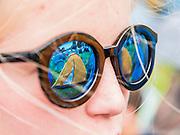 A Norwich Schoolgirl looks at her campsite - The 2016 Latitude Festival, Henham Park, Suffolk.