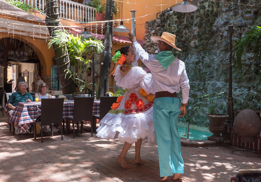 Catagena, Columbia--April 21, 2018. Dancers in traditional garb perform a dance in a restaurant.  Editorial use only.