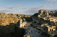 """MATERA, ITALY - 5 OCTOBER 2019: A view of Matera, the set for Milo Rau's """"The New Gospel"""" (2019),  Pier Paolo Pasolni's """"The Gospel According to Matthew"""" (1964) and Mel Gibson's """"The Passion of the Christ (2004), is seen here during the production of """"The New Gospel"""", a film by Swiss theatre director Milo Rau, in Matera, Italy, on October 5th 2019.<br /> <br /> Theatre Director Milo Rau filmed the Passion of the Christ  under the title """"The New Gospel"""" with a cast of refugees, activists and former actors from Pasolini and Mel Gibson's films.<br /> <br /> The role of Jesus is performed by Yvan Sagnet, a Political activist born in Cameroon and who worked on a tomato farm when in 2011 he revolted against the system of exploitation and led the first farm workers' strike in southern Italy. In a series of public shoots in the European Capital of Culture Matera, Jesus will proclaimed the Word of God, was crucified (October 6th 2019) and finally rose from the dead in Rome, the capital of Catholic Christianity and seat of one of the most xenophobic governments in Europe (October 10th 2019).<br />  <br /> Parallel to the film, the humanistic message of the New Testament was transformed into the present: at the beginning of September, the campaign """"Rivolta della Dignità"""" (Revolt of Dignity), which demanded fair working and living conditions     for refugees, global freedom of travel and civil rights for all, started with a march from the southern Italian refugee camps. """"It's about putting Jesus on his feet,"""" director Milo Rau said. Led by Jesus actor Yvan Sagnet, the campaign fights for the rights of migrants who came to Europe via the Mediterranean to be enslaved by the Mafia in the tomato fields of southern Italy and to live in ghettos under inhumane conditions. The campaign and the film thus create a """"New Gospel"""" for the 21st century, a manifesto of solidarity with the poorest, a revolt for a more just and humane world."""