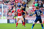 Barnsley midfielder Brad Potts (20) battles with Nottingham Forest defender Michael Mancienne (4)  during the EFL Sky Bet Championship match between Barnsley and Nottingham Forest at Oakwell, Barnsley, England on 15 August 2017. Photo by Simon Davies.