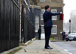 © Licensed to London News Pictures. 20/03/2013. Westminster, UK. Chancellor Of The Exchequer George Osborne poses for photographers whilst holding his red ministerial box outside 11 Downing Street In London, before presenting his annual budget to parliament today 19th March 2013. Photo credit : Stephen Simpson/LNP