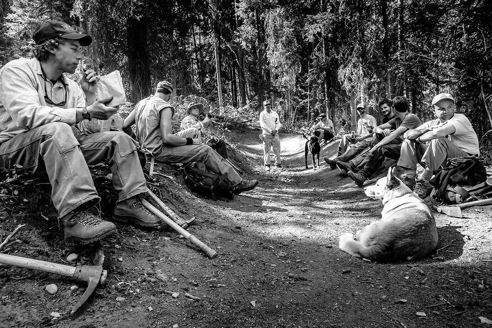 Trail builders take a break during a Teton Freedom Riders build day on the Lithium singletrack.