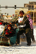 3/3/2007:  Anchorage Alaska -  Veteran Tim Osmar of Ninilchik, AK takes the first turn on 4th Avenue onto Cordova fast during the Ceremonial Start of the 35th Iditarod Sled Dog Race