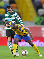 20091105: LISBON, PORTUGAL - Sporting Lisbon vs Ventspils: Europa League 2009/2010 - Group Stage. In picture: Joao Martins (VENT) and Tonel (SPO). PHOTO: Alexandre Pona/CITYFILES
