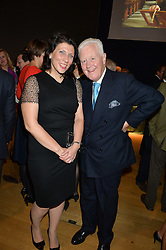 SIR BENJAMIN SLADE and IRINA ALEKSEEVA at a party to celebrate the publication of Capability Brown & Belvoir - Discovering a lost Landscape by The Duchess of Rutland, held at Christie's, 8 King Street, St.James, London on 7th October 2015.