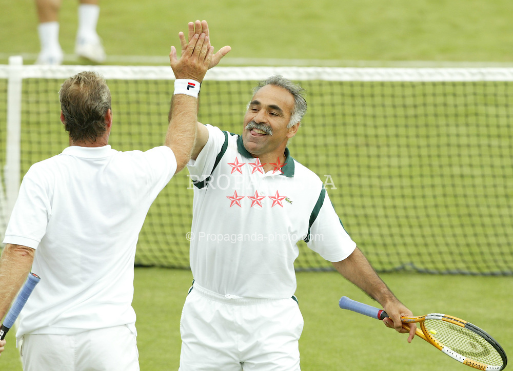 LIVERPOOL, ENGLAND - THURSDAY JUNE 10 2004: Mansour Bahrami (r) celebrates with partner Peter McNamara during at the Liverpool International Tennis tournament in Claderstones Park, Liverpool. (Photo by David Rawcliffe/Propaganda)