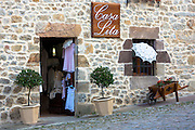 Clothing gifts and souvenirs in Casa Lita shop in Calle Del Racial in Santillana del Mar, Cantabria, Northern Spain