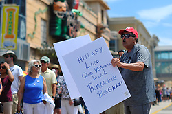 A Trump supporter attends a July 7th, 2016 campaign stop of Hillary Clinton at the closed Trump Plaza Casino on the Boardwalk in Atlantic City, New Jersey.