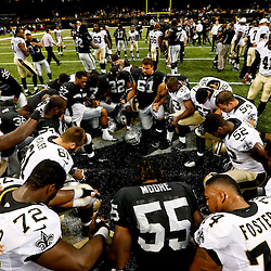Aug 16, 2013; New Orleans, LA, USA; New Orleans Saints and Oakland Raiders players huddle up in prayer following a preseason game at the Mercedes-Benz Superdome. The Saints defeated the Raiders 28-20. Mandatory Credit: Derick E. Hingle-USA TODAY Sports