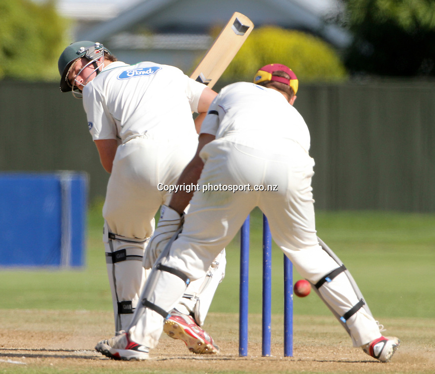 Central's Wil Young watches the ball go between the legs of Northern's wicketkeeper, Pete McGlashan in the teams Plunket Shield cricket match at Nelson Park, Napier, New Zealand. Wednesday 28 March, 2012. Photo: John Cowpland / phtosport.co.nz